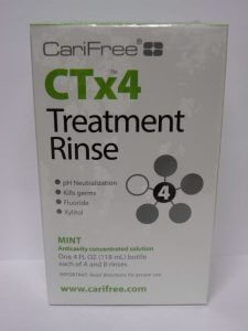 CariFree's CTx4 (Caries Treatment x4) Treatment Rinse. It is a two-bottle system, A and B, that one mixes together just prior to using. The treatment period is typically twice a day for two weeks.